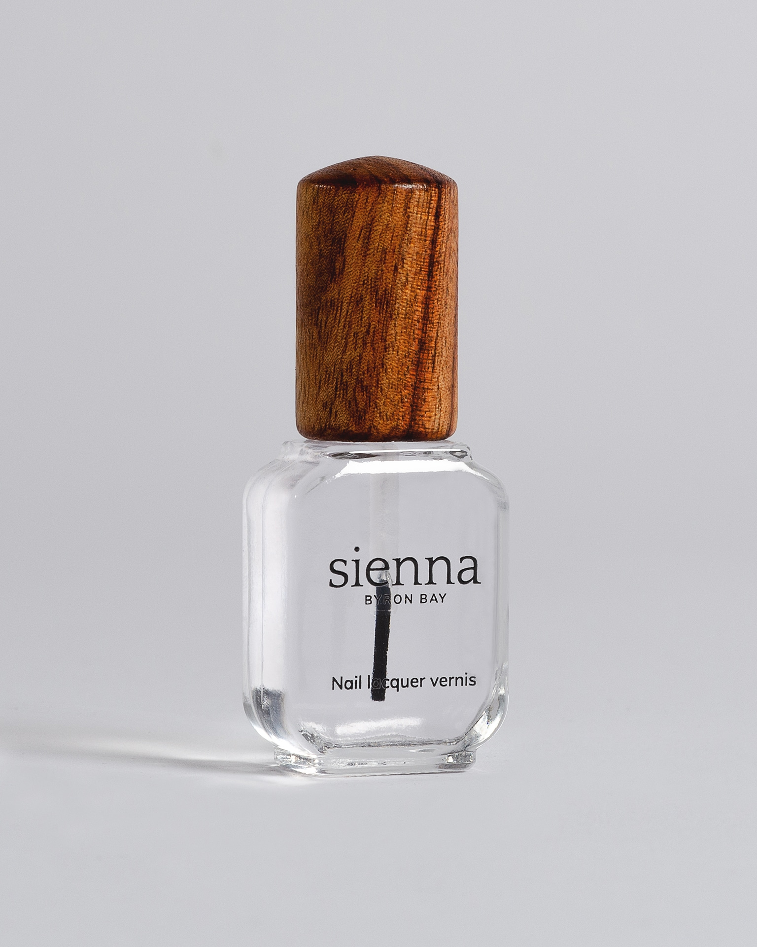 clear base coat nail polish bottle with timber cap by sienna