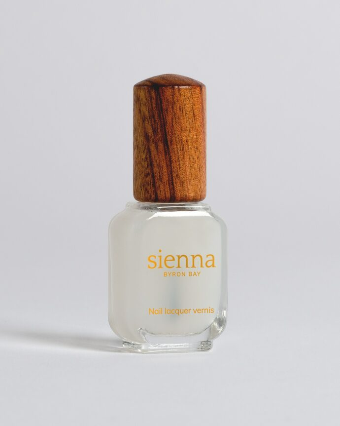 matte top coat nail polish bottle with timber cap by sienna
