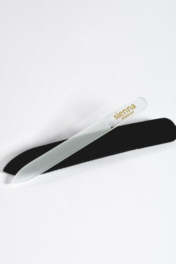 glass nail file on top of black sleeve by sienna