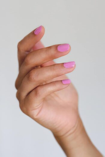 Light Orchid pink nail polish hand swatch on medium skin tone by sienna