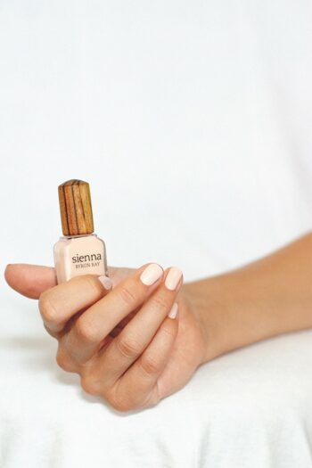 Powder pink nail polish hand swatch on fair skin tone by sienna