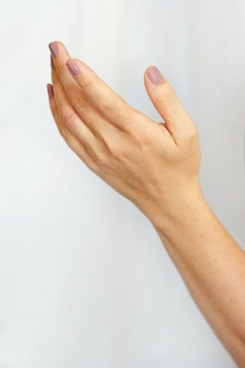 Mauve nail polish on fair skin tone