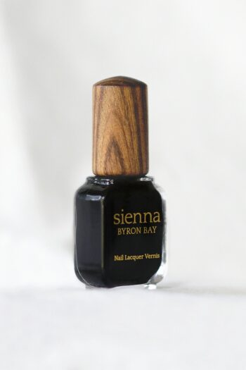 Jet black nail polish glass bottle with timber cap by sienna
