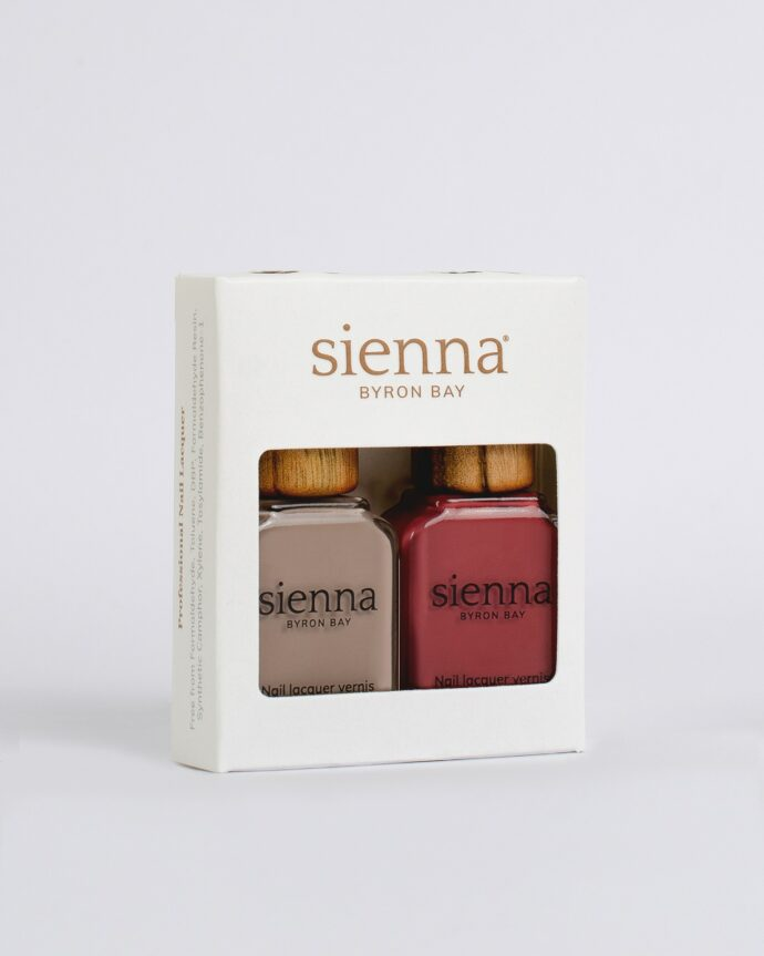beige and red nail polish glass bottles with timber cap in white cardboard box by sienna