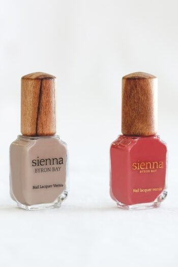 Beige and red nail polish glass bottle with timber cap by sienna