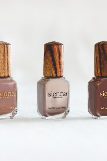 three neutral brown nail polish in glass bottle with timber cap by Sienna