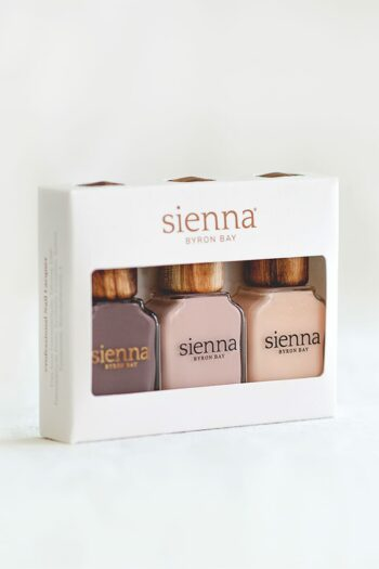 three neutral and nude nail polish in glass bottles with timber cap in a box by Sienna