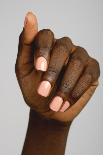 nude pink nail polish hand swatch on dark skin tone by sienna