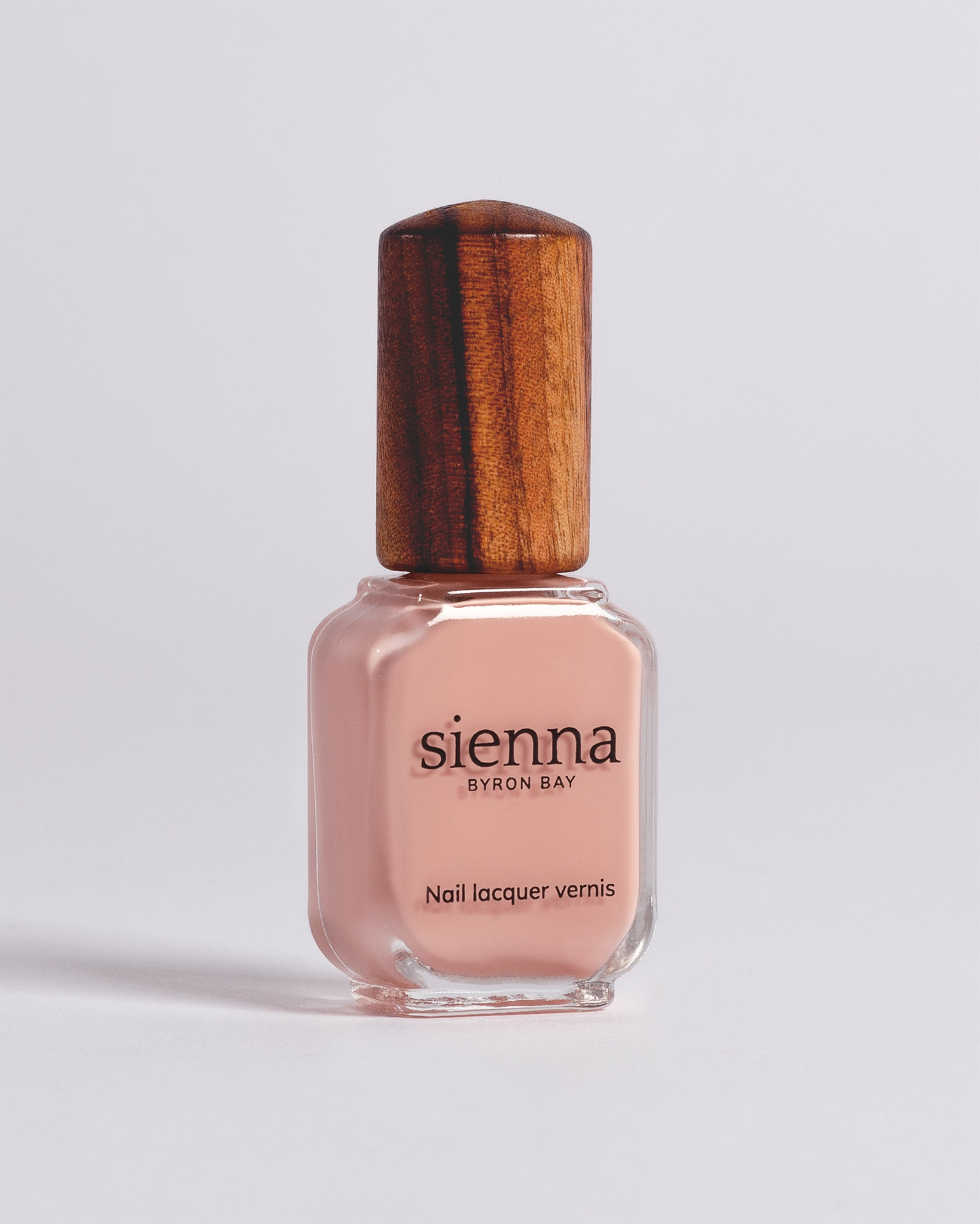 nude pink nail polish bottle with timber cap by sienna