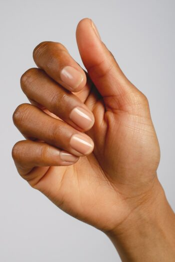 nude sheer nail polish hand swatch on medium skin tone by sienna