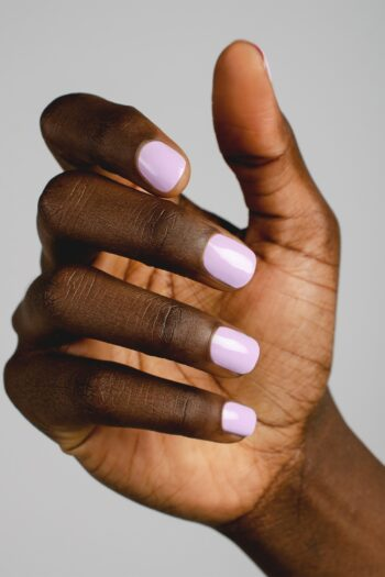 lilac nail polish hand swatch on dark skin tone by sienna