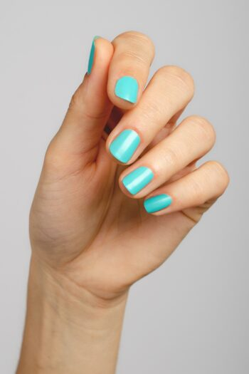 aqua nail polish hand swatch on fair skin tone by sienna