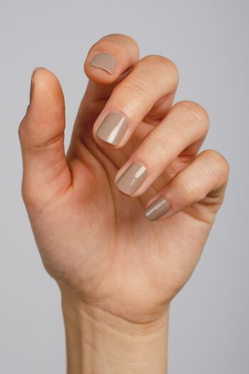 beige nail polish hand swatch on fair skin tone by sienna