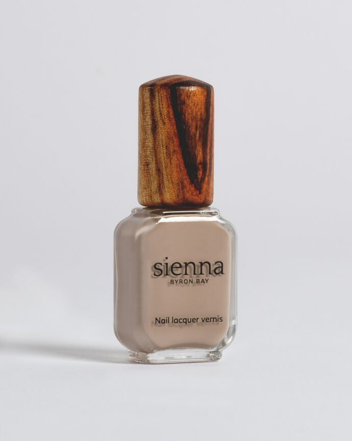 beige nail polish bottle with timber cap by sienna