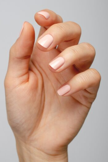 pastel pink nail polish hand swatch on fair skin tone by sienna