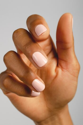 pastel pink nail polish hand swatch on medium skin tone by sienna