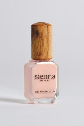 pastel pink nail polish bottle with timber cap by sienna