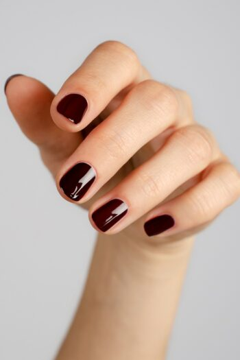 dark red nail polish hand swatch on fair skin tone by sienna