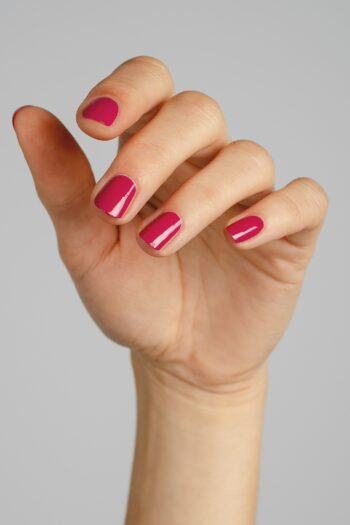 pink fuschia nail polish hand swatch on fair skin tone by sienna