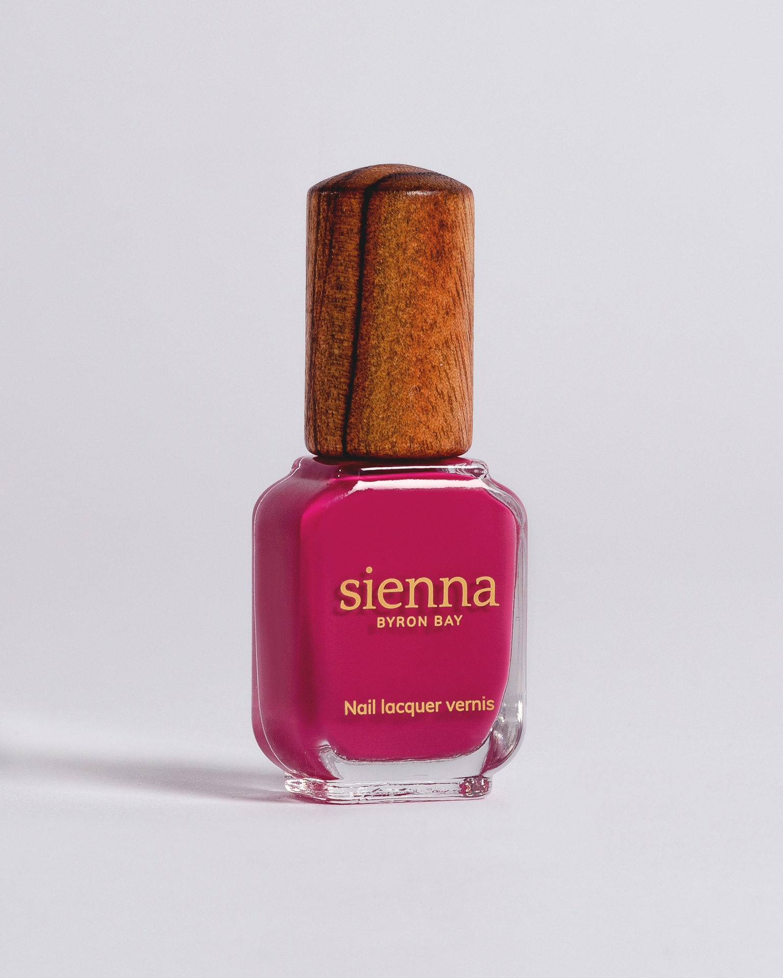 pink fuschia nail polish bottle with timber cap by sienna
