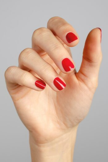 classic red nail polish hand swatch on fair skin tone by sienna