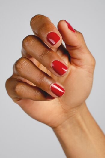 classic red nail polish hand swatch on medium skin tone by sienna