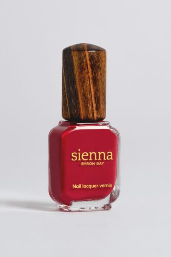 classic red nail polish bottle with timber cap by sienna