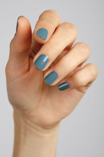 blue grey nail polish hand swatch on fair skin tone by sienna