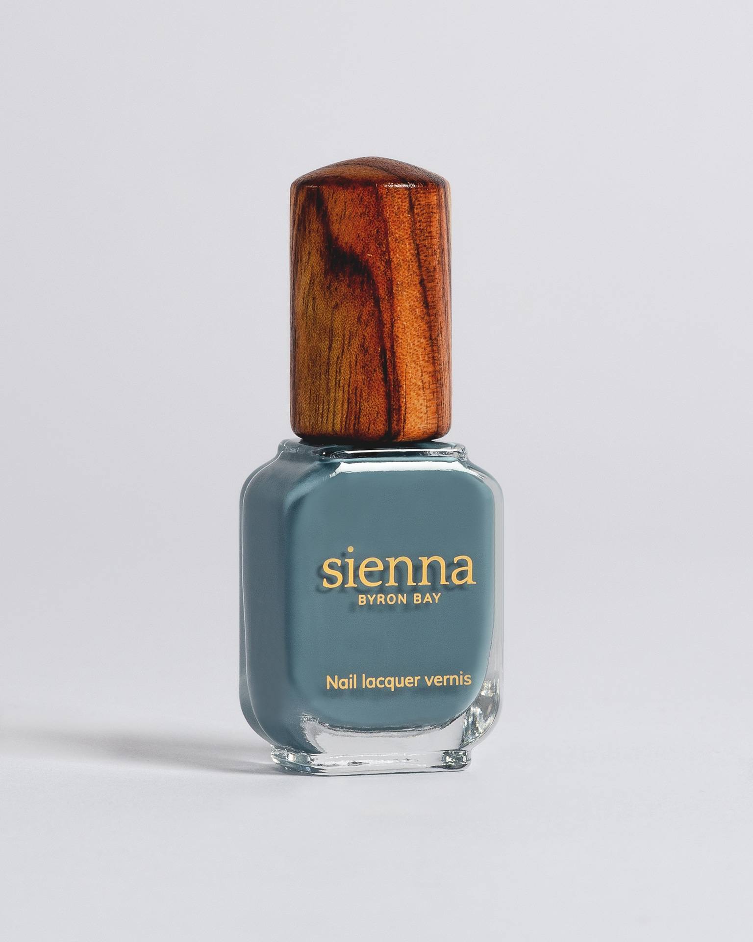 blue grey nail polish bottle with timber cap by sienna