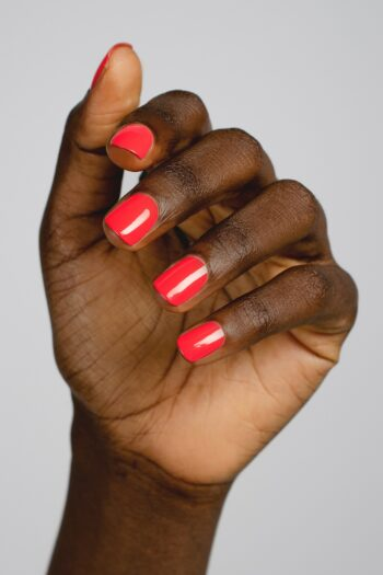 barbie pink nail polish hand swatch on dark skin tone by sienna
