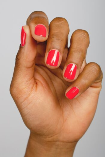 barbie pink nail polish hand swatch on medium skin tone by sienna
