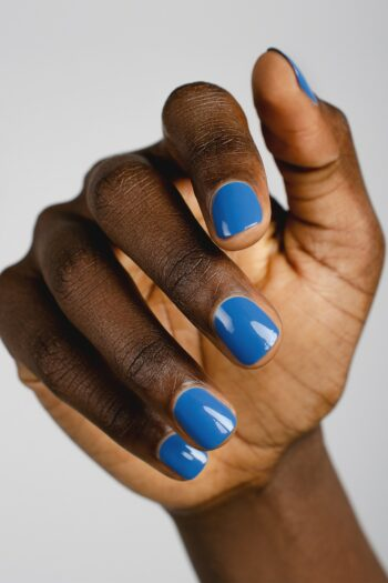 blue nail polish hand swatch on dark skin tone by sienna