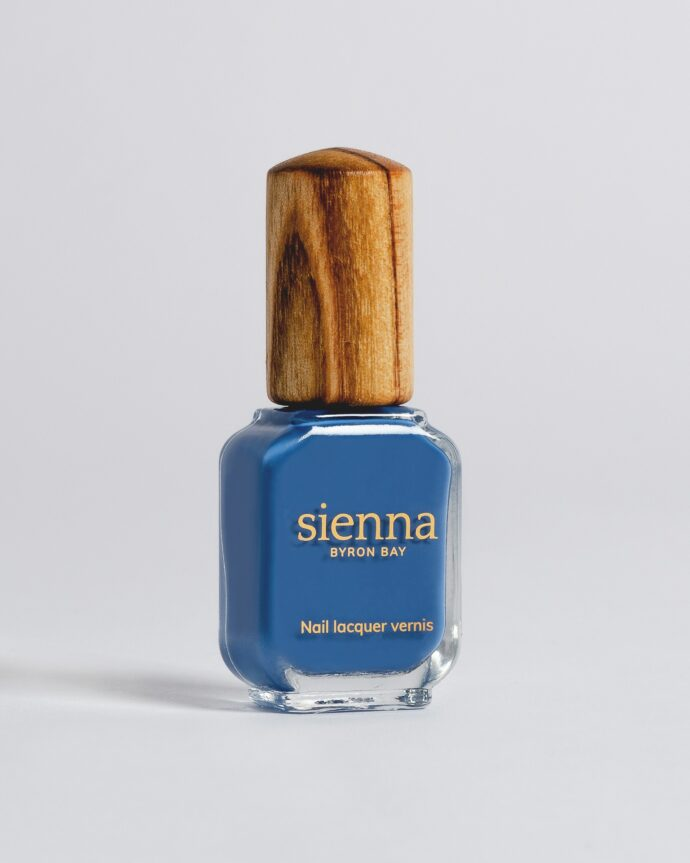 blue nail polish bottle with timber cap by sienna