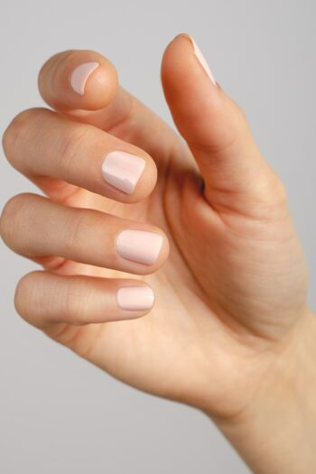 light pink nail polish hand swatch on fair skin tone by sienna