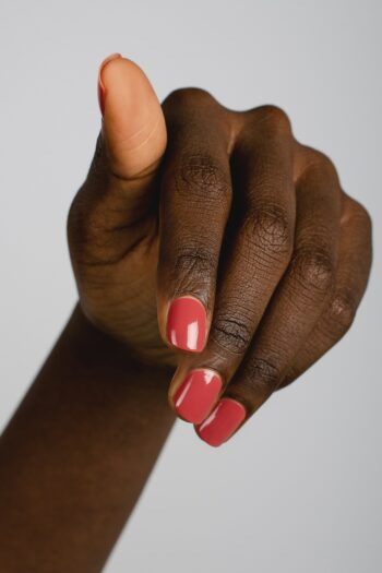 dusty red nail polish hand swatch on dark skin tone by sienna