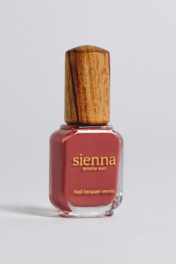 dusty red nail polish bottle with timber cap by sienna