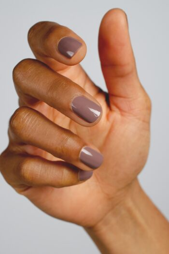 purple grey nail polish hand swatch on medium skin tone by sienna