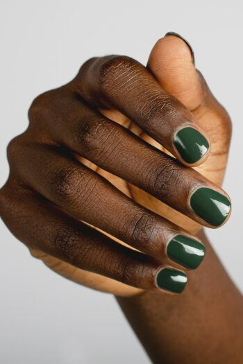 dark green nail polish hand swatch on dark skin tone by sienna