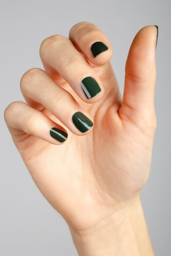 dark green nail polish hand swatch on fair skin tone by sienna