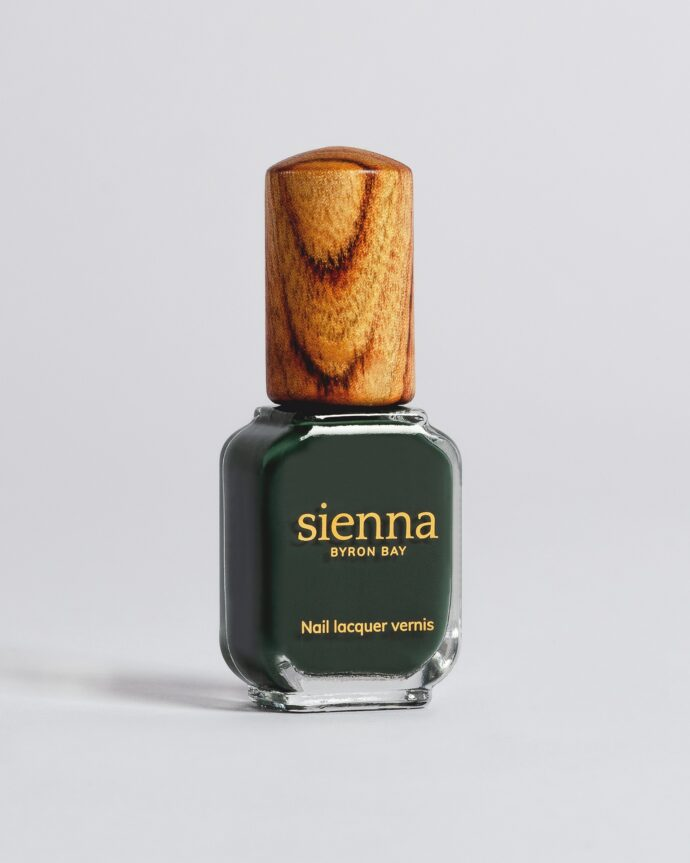 dark green nail polish bottle with timber cap by sienna