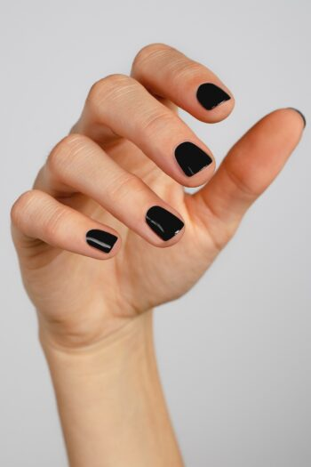 black nail polish hand swatch on fair skin tone by sienna