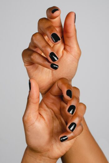 black nail polish hand swatch on medium skin tone by sienna