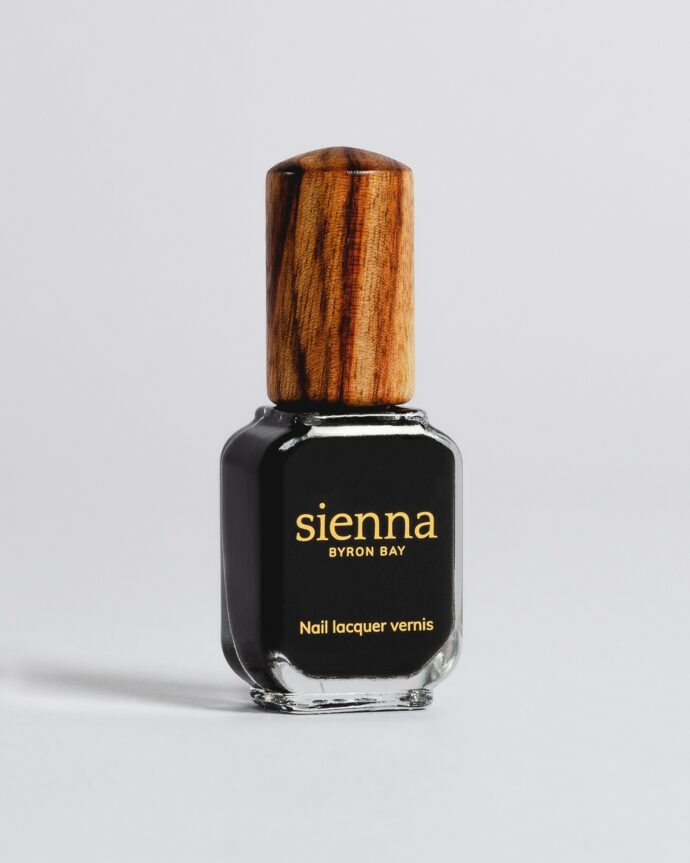 black nail polish bottle with timber cap by sienna