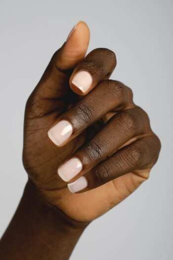 light pink sheer nail polish hand swatch on dark skin tone by sienna