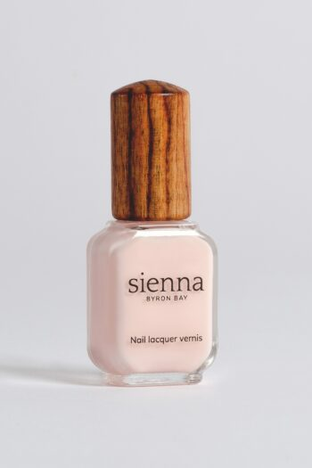 light pink sheer nail polish bottle with timber cap by sienna