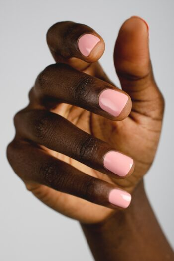 mid-tone pink nail polish hand swatch on dark skin tone by sienna