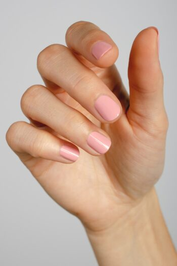 mid-tone pink nail polish hand swatch on fair skin tone by sienna