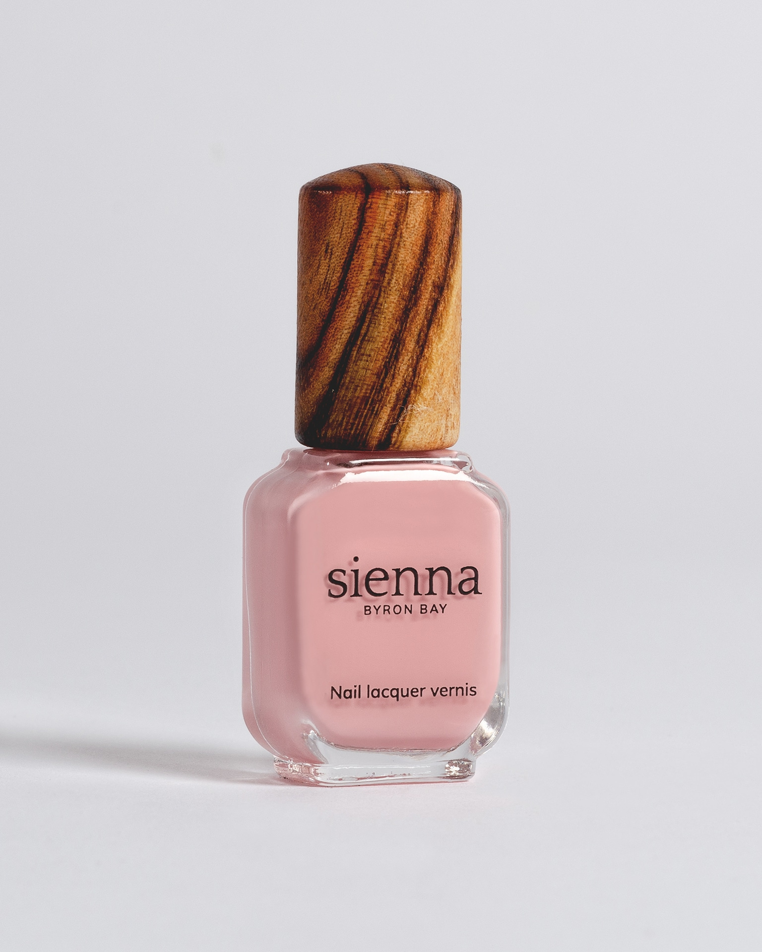 light pink nail polish bottle with timber cap by sienna