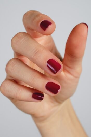 plum red nail polish hand swatch on fair skin tone by sienna