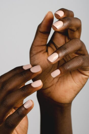 light nude nail polish hand swatch on dark skin tone by sienna
